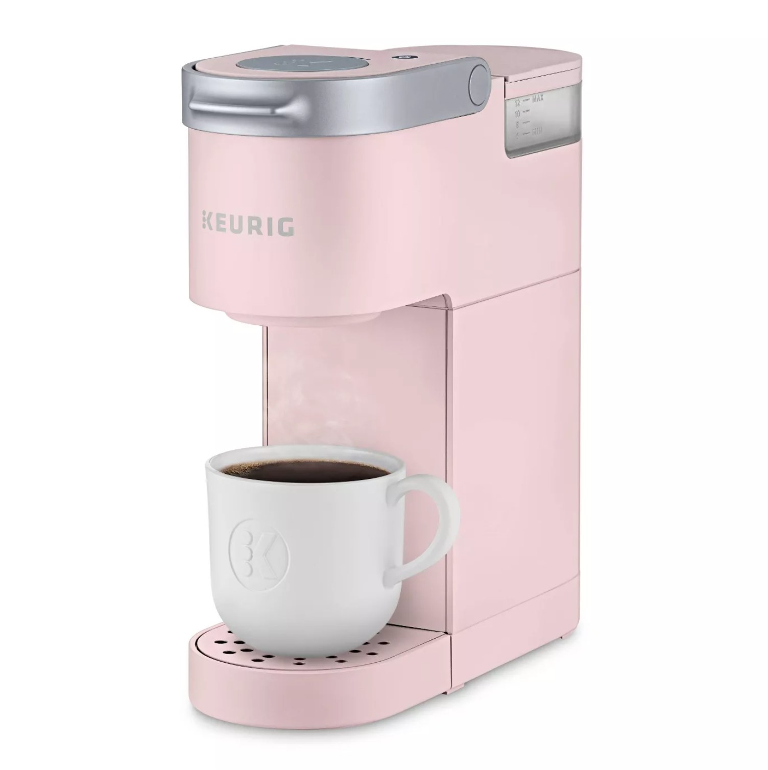 The Keurig in dusty rose color with a cup of coffee