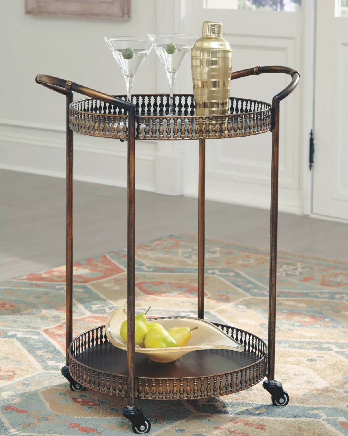The bar cart with a shaker and two martinis on top