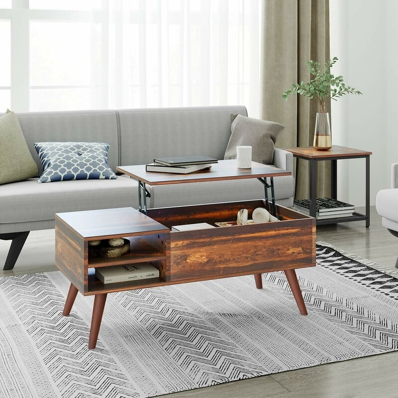 A brown, wooden coffee table with two shelves and a lift-top feature for added storage space in your living room or home office