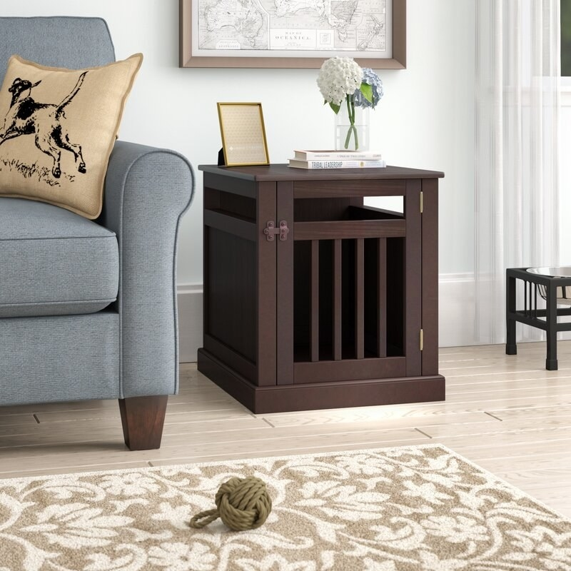 A brown, chew-resistant wooden pet crate that doubles as an end table or nightstand