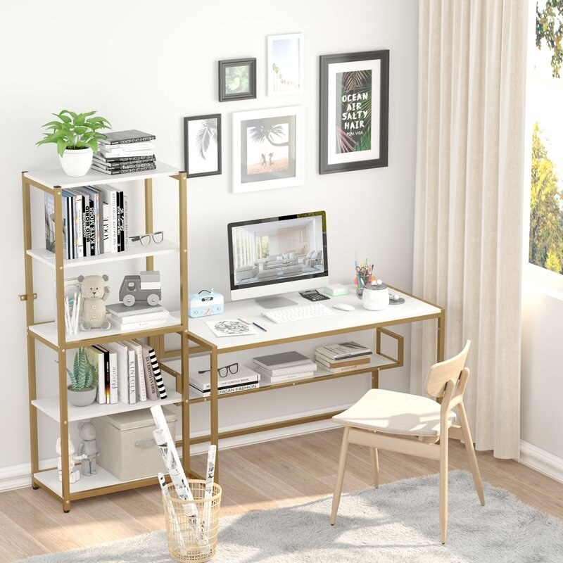 A white, wooden reversible desk with a gold steel base designed with 5 shelves
