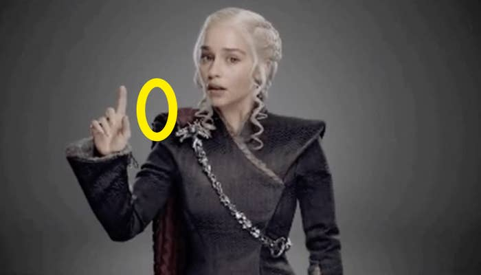 Daenerys holding up her pointer finger with a 0 drawn next to it to spell out 10