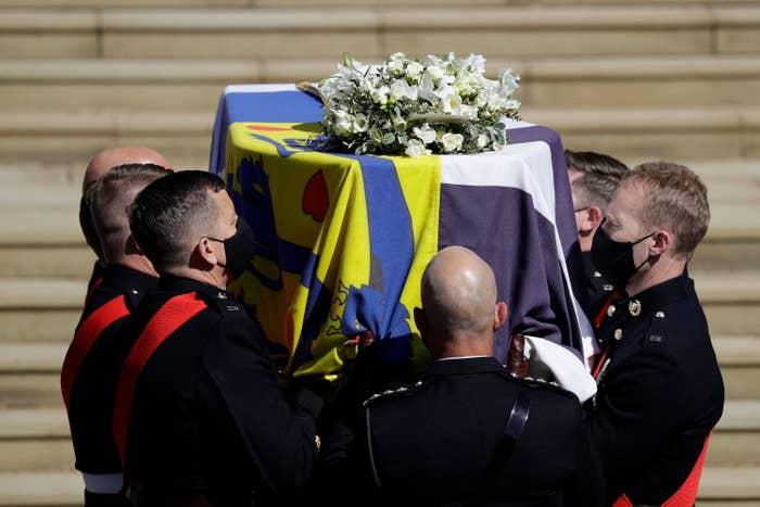 Pallbearers carry Prince Philip's casket