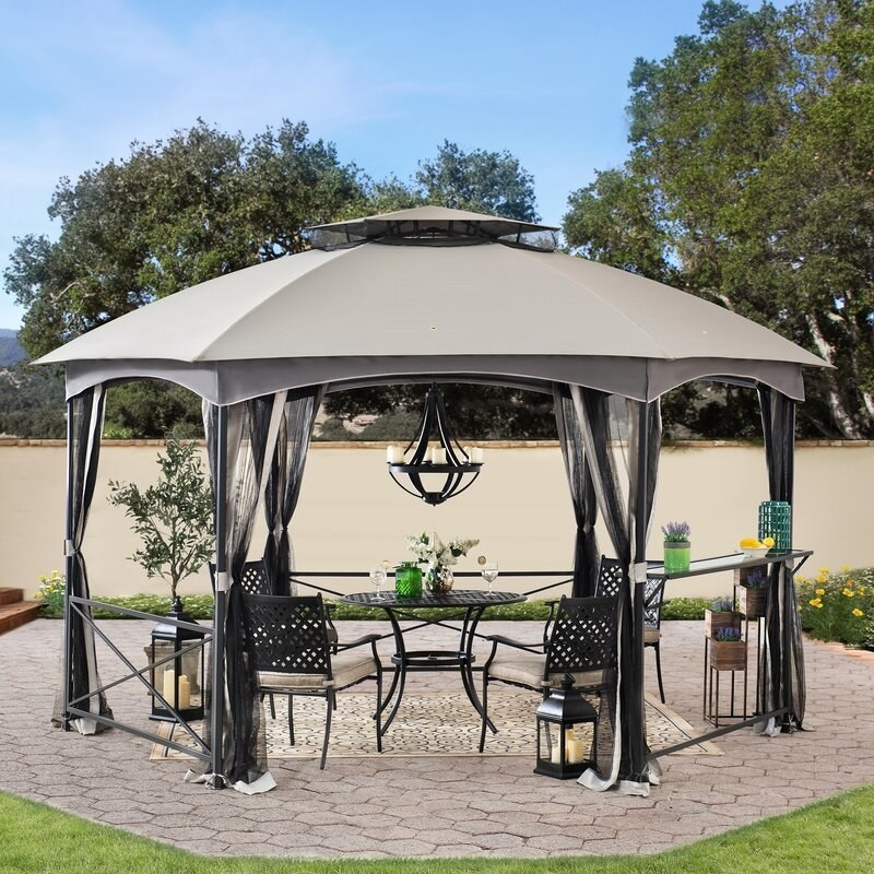A steel patio gazebo with attached screens for when it rains