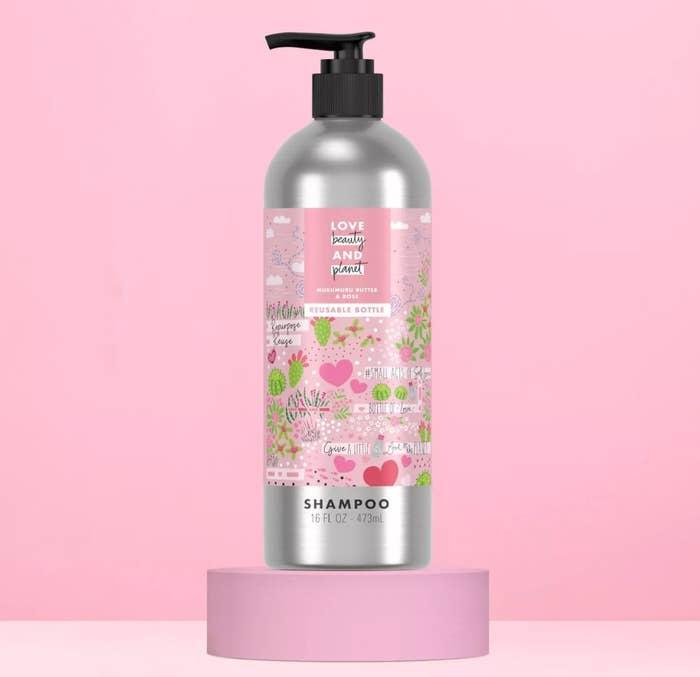 Bottle of shampoo against pink background