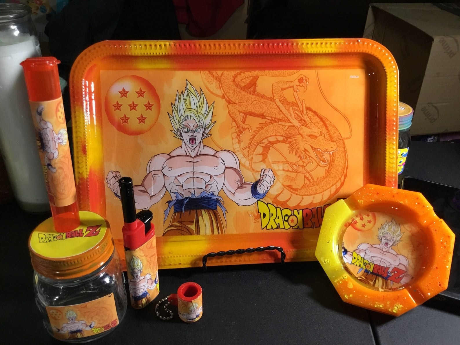 the set with a tray, jar, lighter, and ashtray with the Dragon Ball Z images all over it