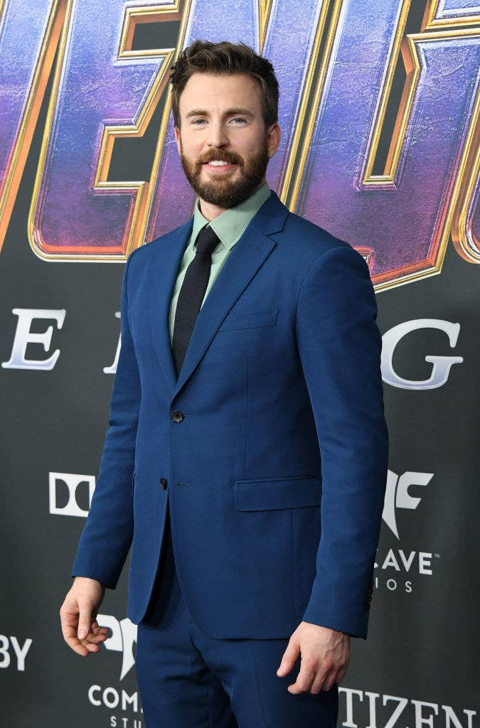 Chris posing on a red carpet