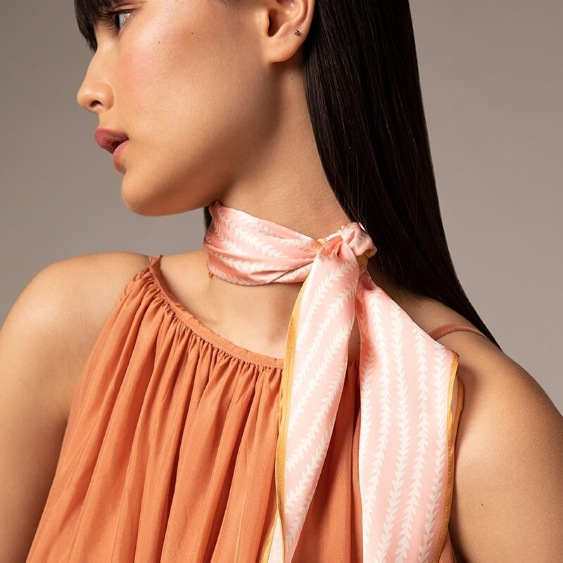 A person wearing the scarf around their neck