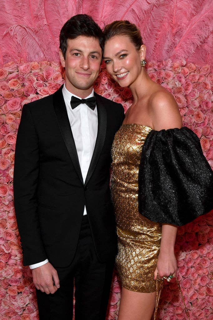 Joshua in a black suit with bow-tie and Karlie in a short gold dress