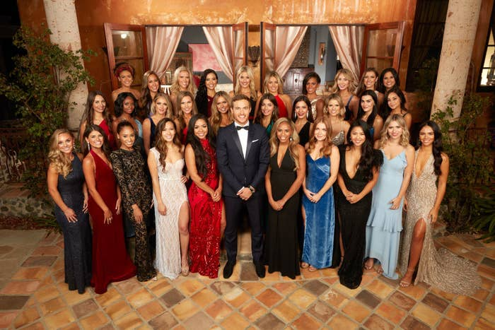 Peter standing with the contestants