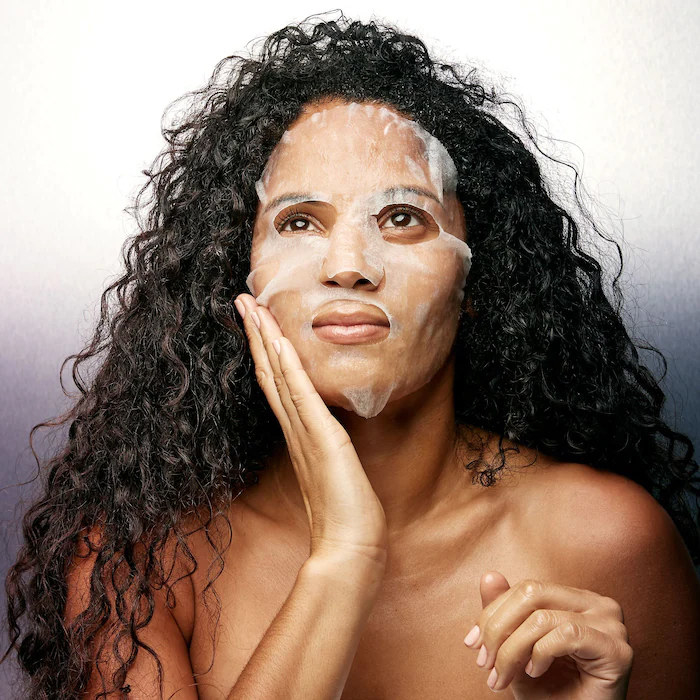 A person wearing a sheet mask