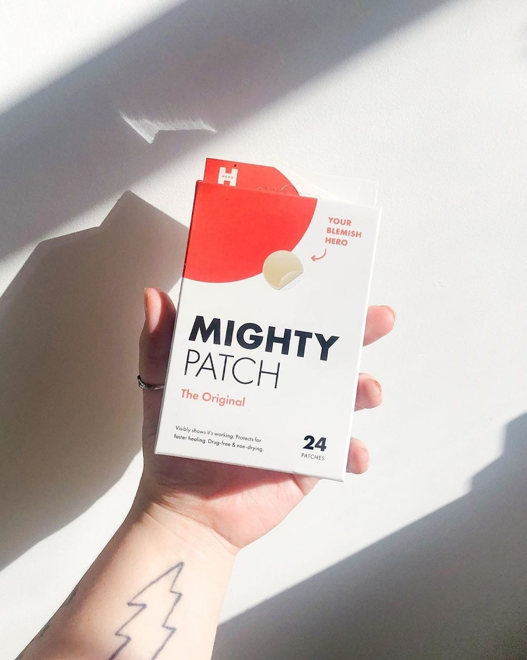 hand holding package of Mighty Patch zit patches