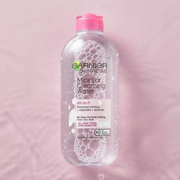 Garnier micellar water against pink background