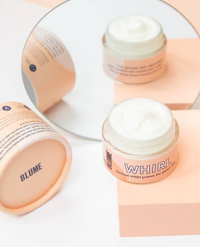 An open jar of face cream