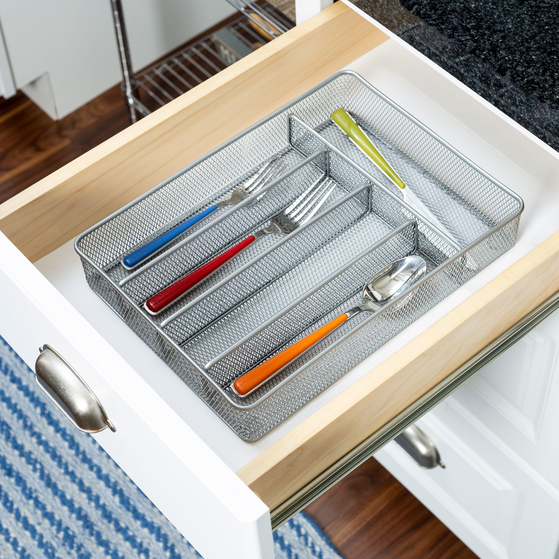 silver mesh utensil organizer inside a drawer