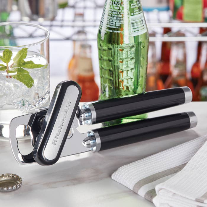 black and silver manual can opener on a table