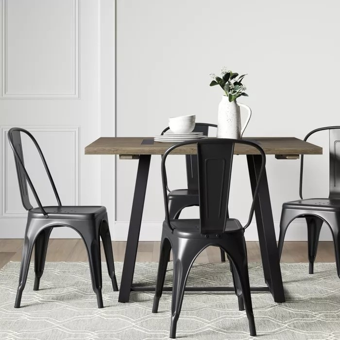 The brown and black dining table