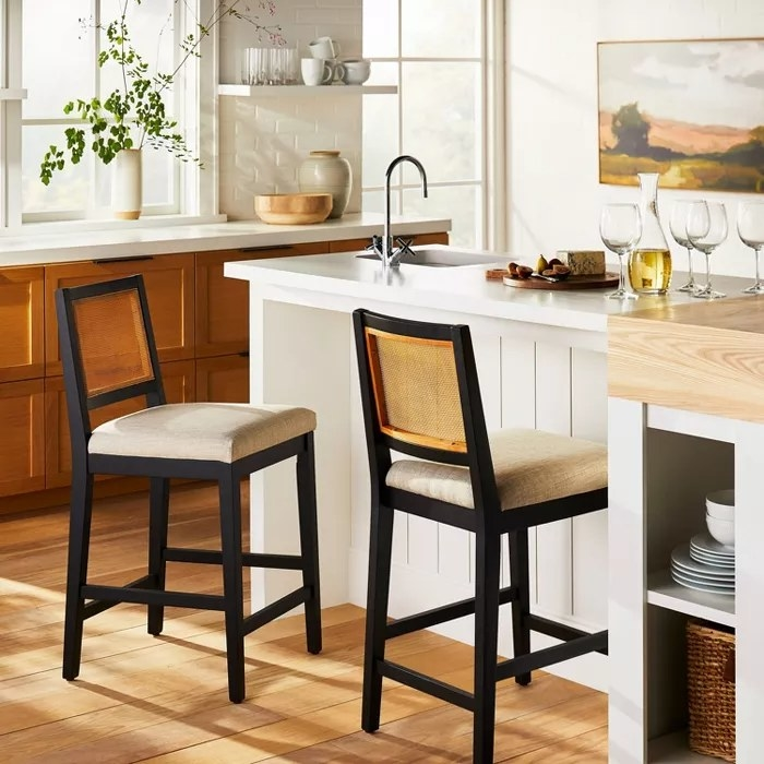 The counter stool with a black frame and cane backing