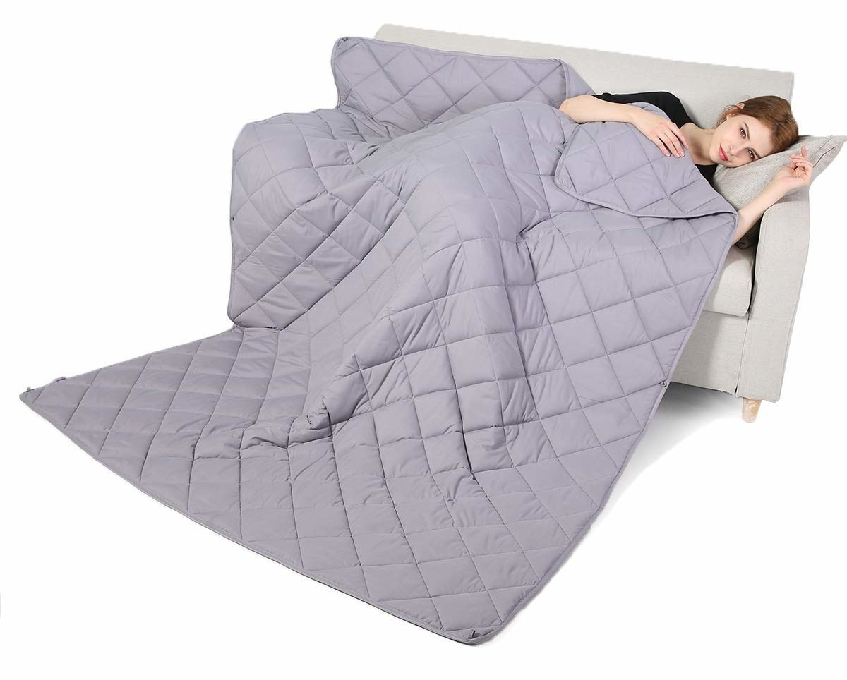 A woman using the weighted blanket.