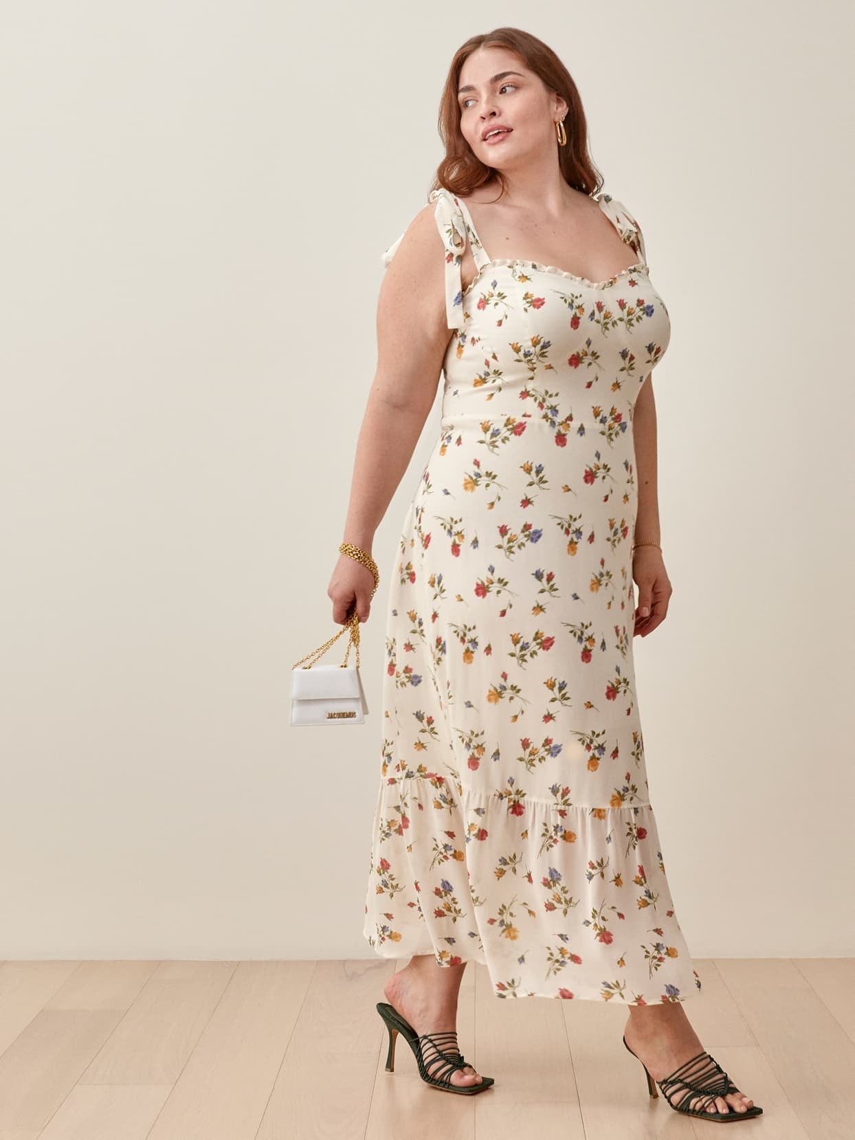 Model wearing the cream and floral print dress