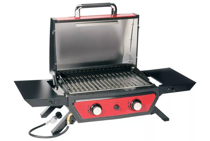 The red grill with the top open