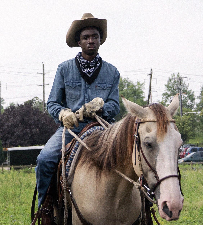 Cole riding his horse Boo