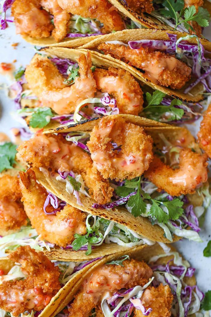 Breaded bang bang shrimp tacos with slaw.
