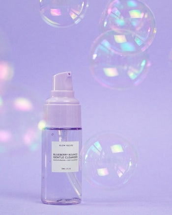 the small purple bottle of cleanser