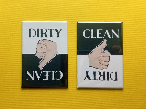 two black and white dishwasher magnets that both say the words dirty and clean