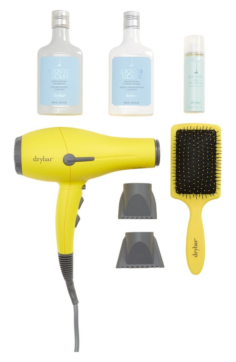 dryer, two attachments, paddle brush, liquid glass shampoo and conditioner, and detox dry shampoo