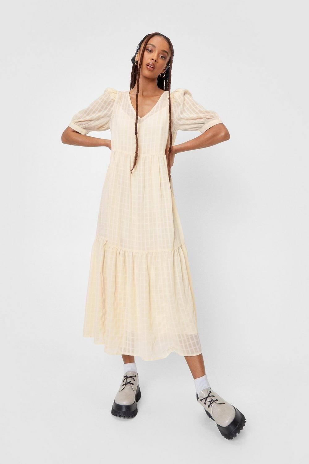 a maxi dress with subtle puff sleeves