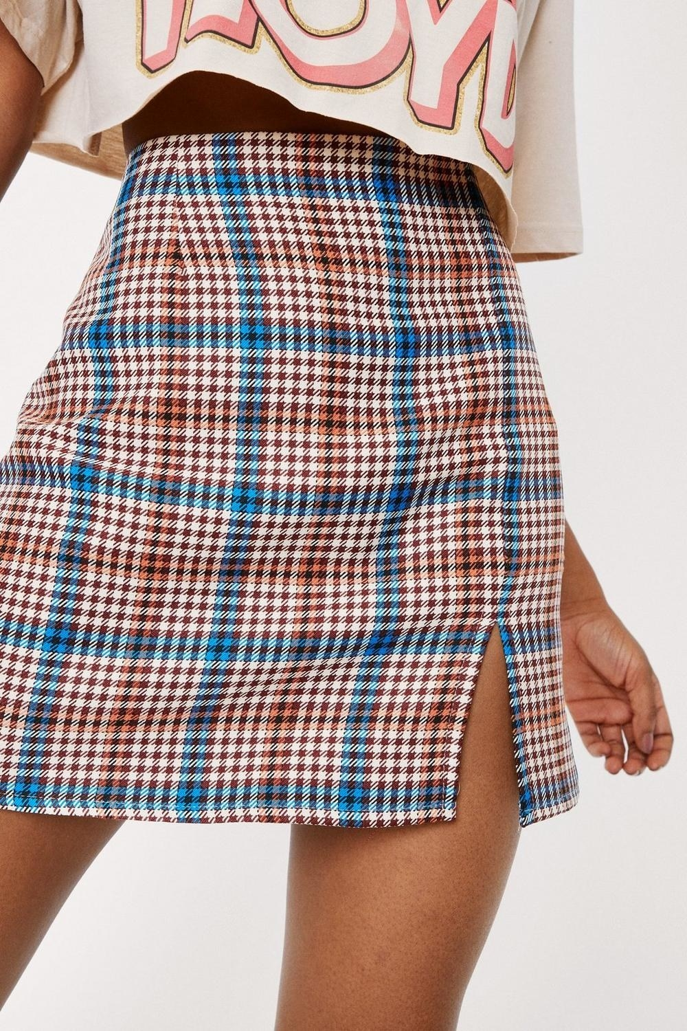 a checkered mini skirt with a slit on the leg