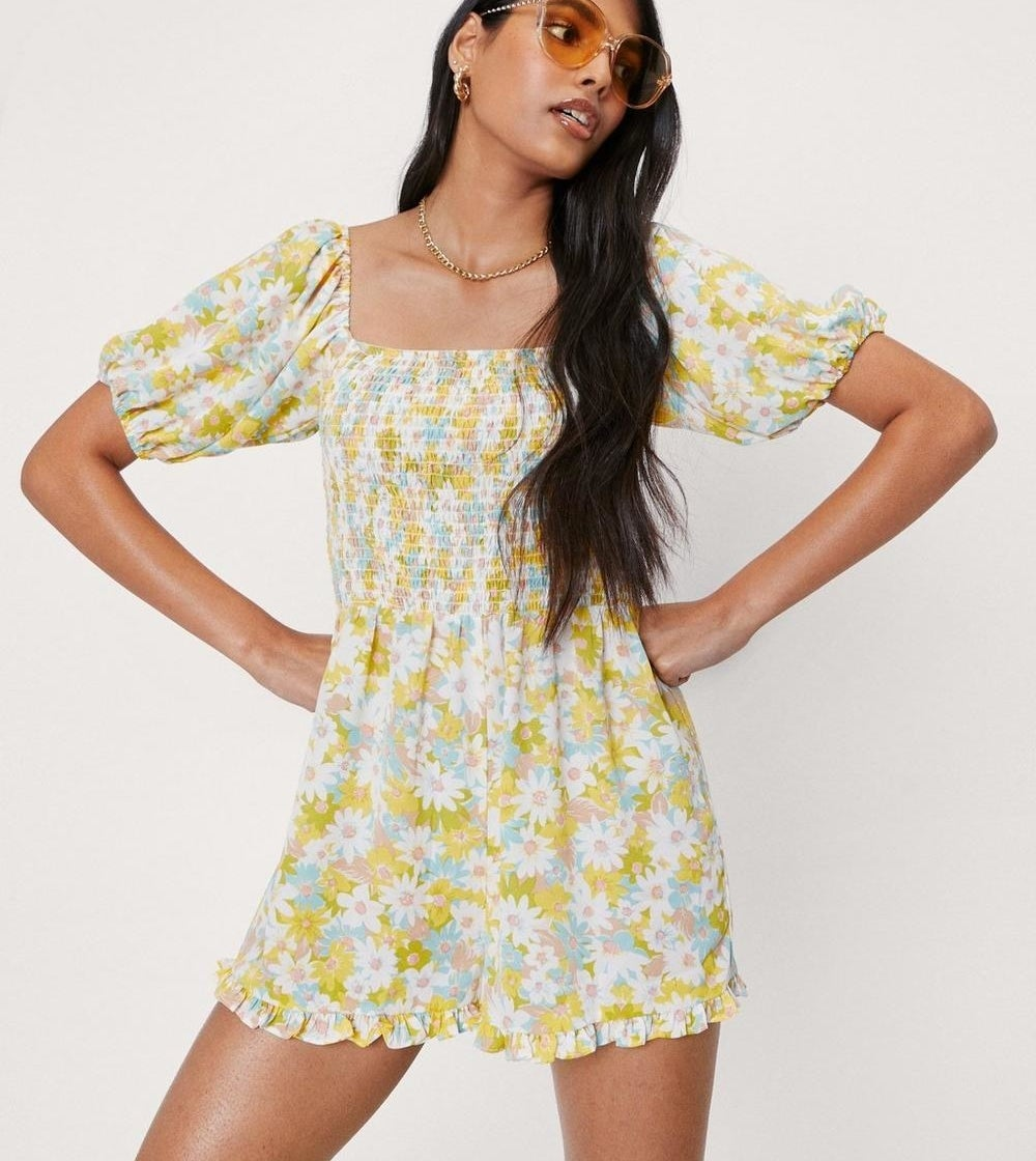 a floral romper with puff sleeves