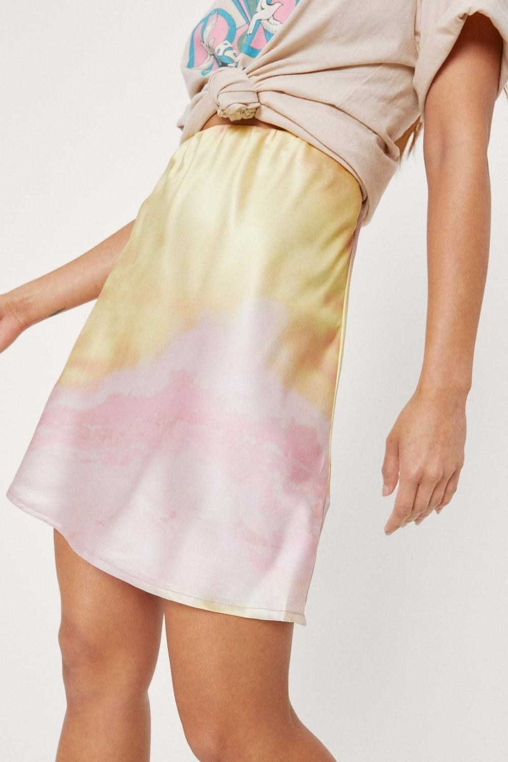 a satiny mini skirt with a subtle tie dye pattern