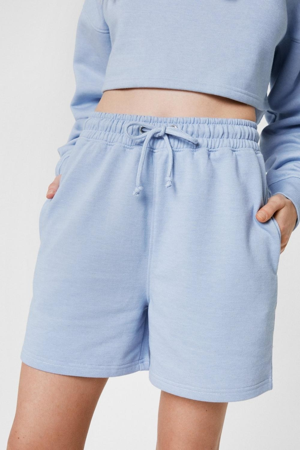 a pair of jogger shorts with pockets and a drawstring waist
