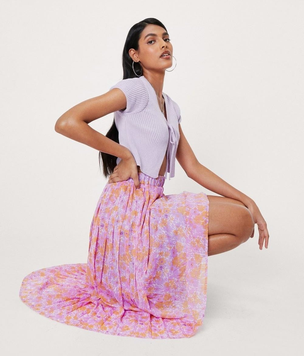 a person wearing a flowy floral skirt