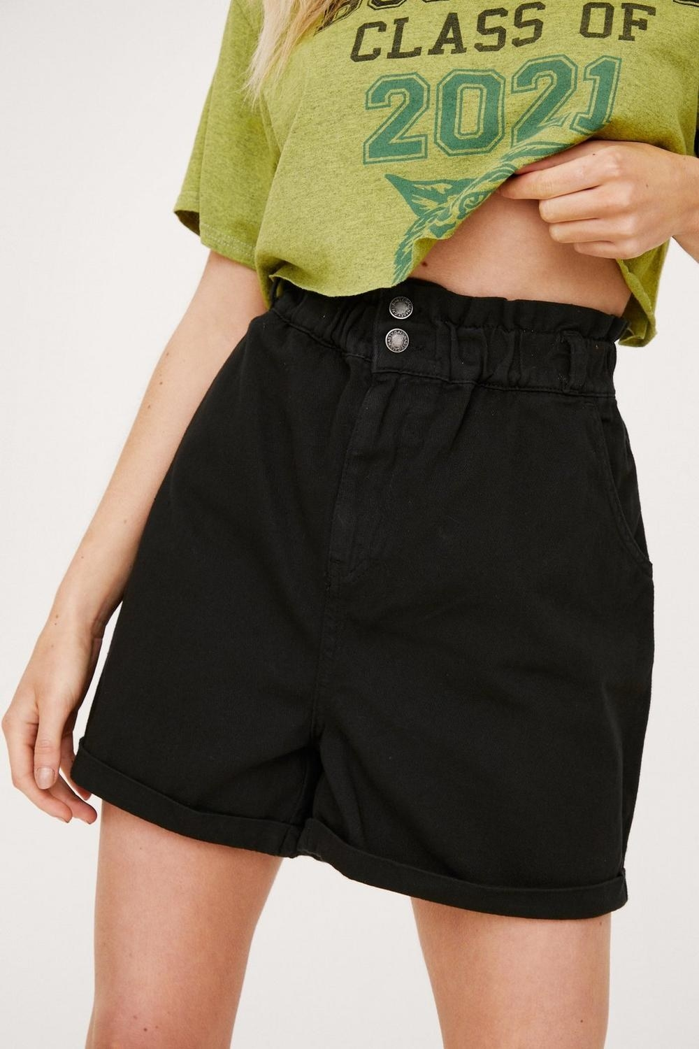 A pair of high waisted shorts that cinch at the waist