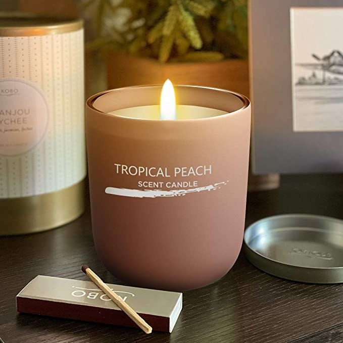 A peach-scented candle