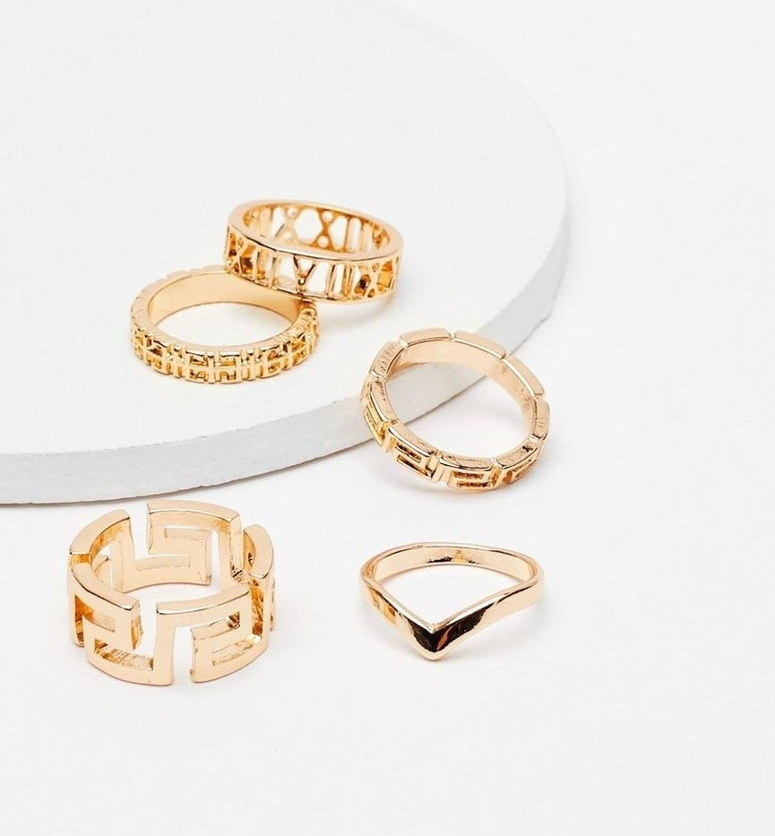 five geometric rings of various shapes