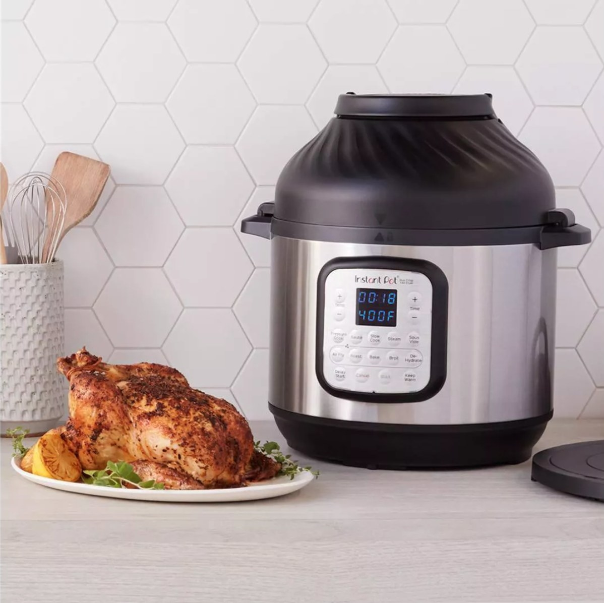 The eight quart instant pot next to a full chicken