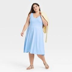 Model wearing light blue dress, goes past the knee