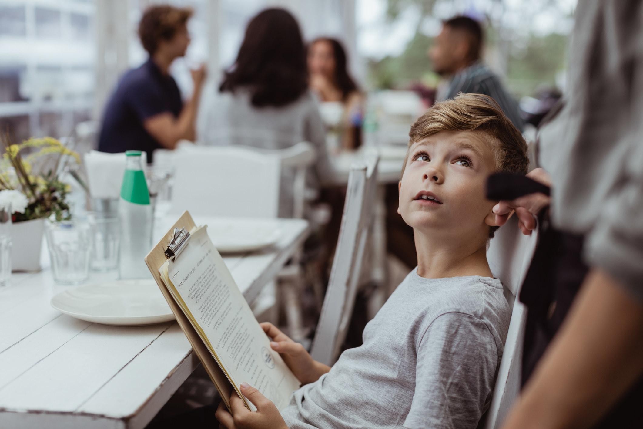 a kid ordering off a menu
