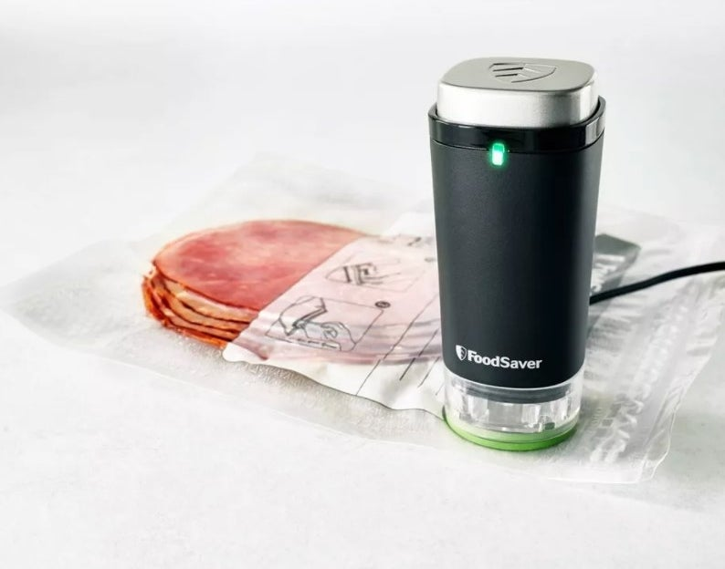 The handheld vacuum sealer in black