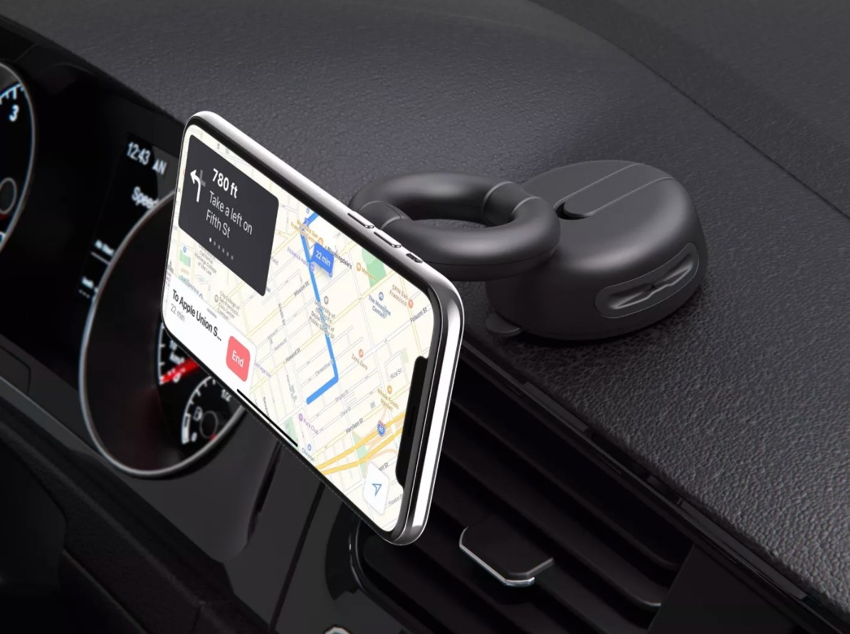 The car dashboard and windshield mount in black holding a phone using GPS
