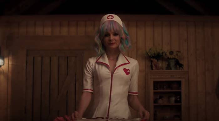 """Carey Mulligan dressed as a nurse, pretending to be a stripper in """"Promising Young Woman"""""""