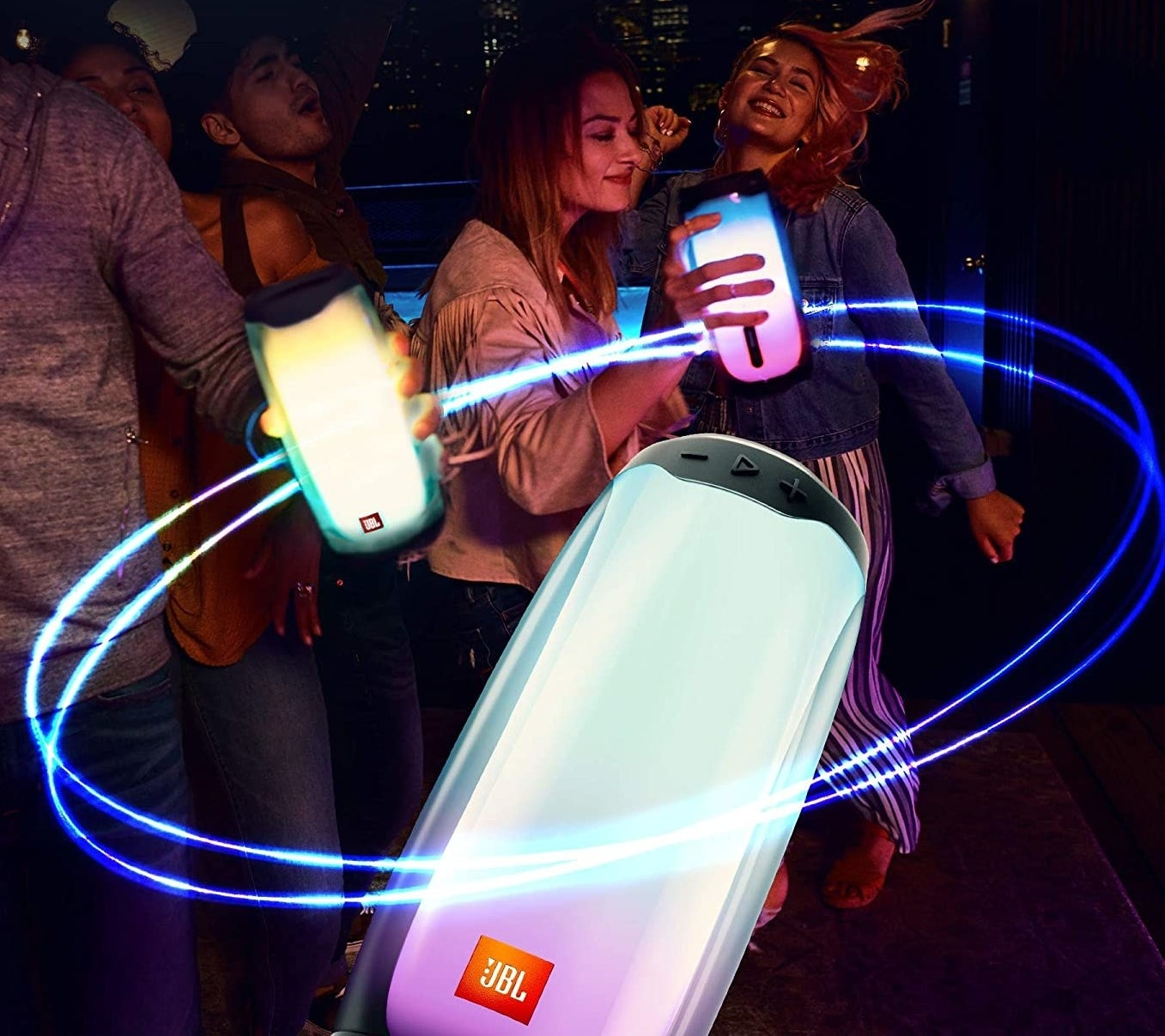 People partying while holding the speakers in their hand.