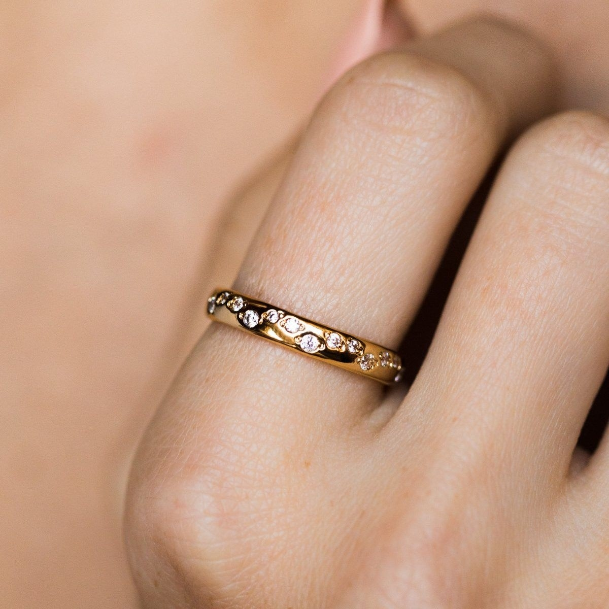a gold band with sparkly stones throughout