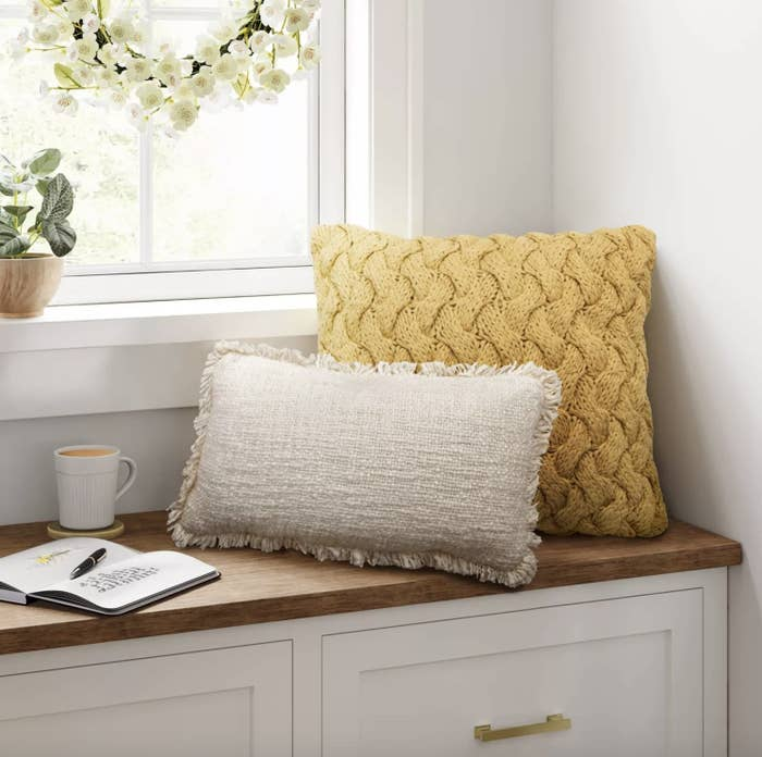 Chunky knit sweater on bay window bench