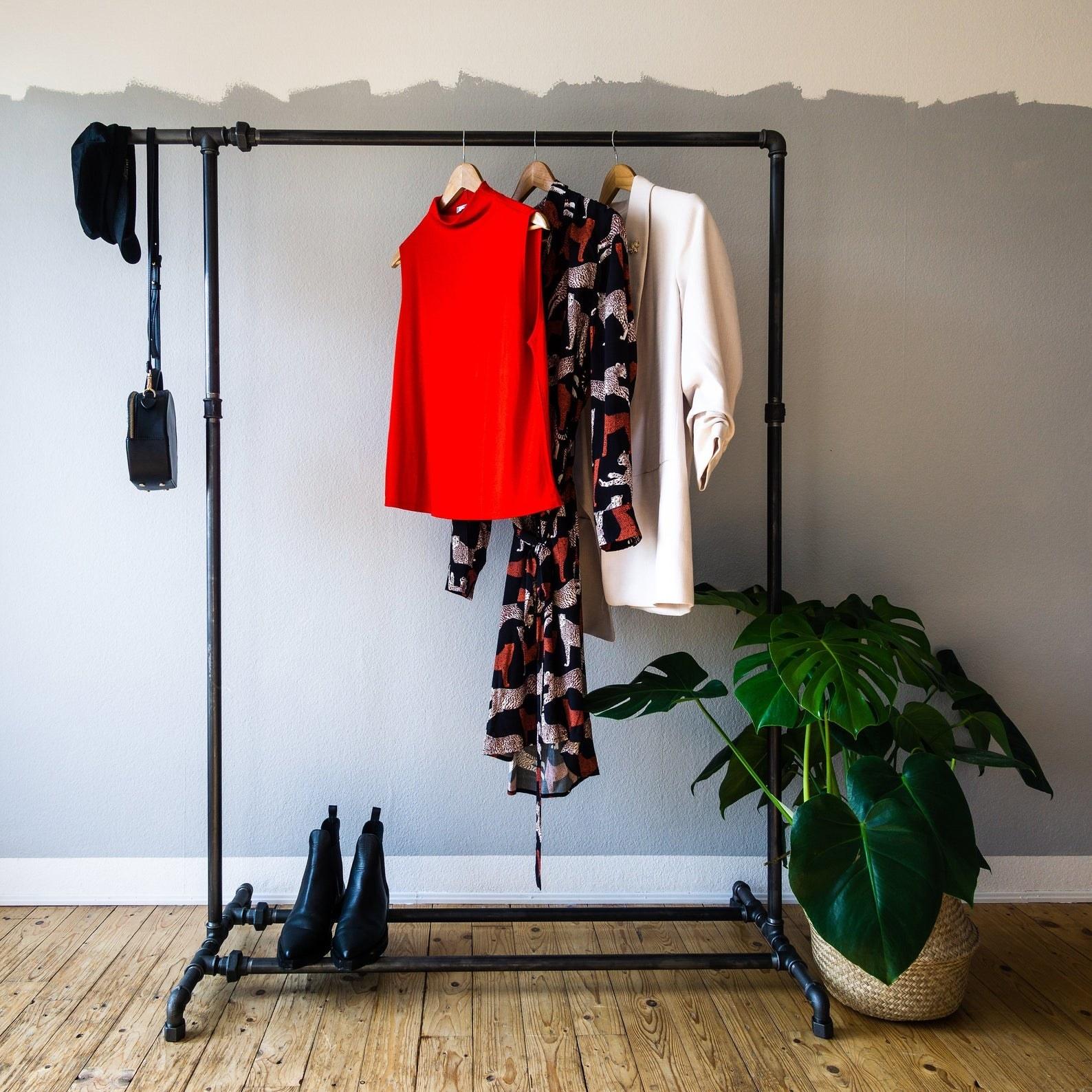 Coat and shoe rack in room