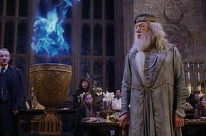 Dumbledore standing next to the goblet of fire